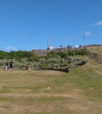 People playing golf at Beeston Hills Putting Green in Sheringham