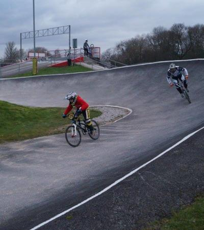 Boys racing on track at Sloughbottom Park BMX Track in Norwich
