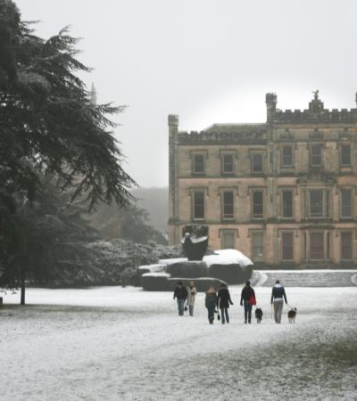 People walking through snow at Elvaston Castle