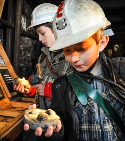 Kids holding rocks at National Coal Mining Museum in Wakefield