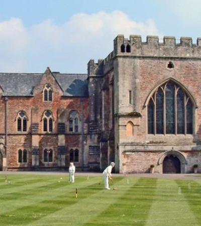 People playing croquet at The Bishops Palace in Wells