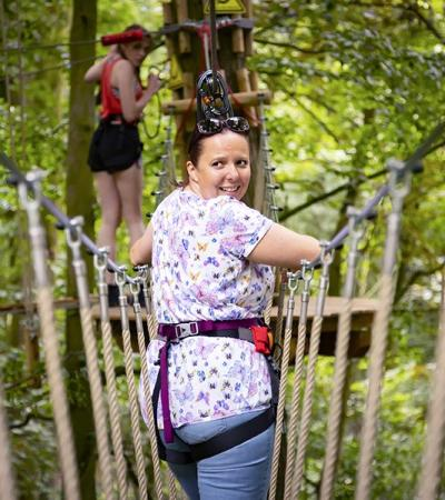 Woman on high ropes at Go Ape Woburn