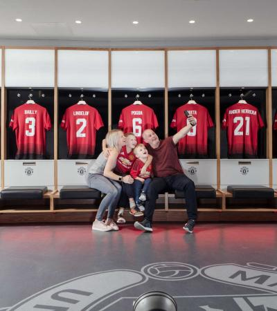 Family taking a photo at Manchester United Museum