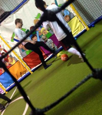 Kids play indoor football at Cheeky Monkees in Corby