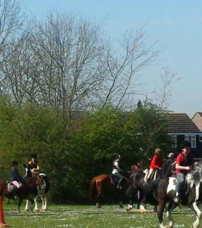 Kids horse riding at Sunshine Riding School in Luton
