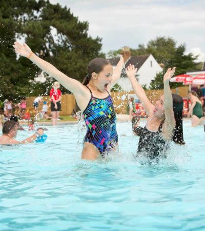 Families swimming at Hinksey Outdoor Pool in Oxford