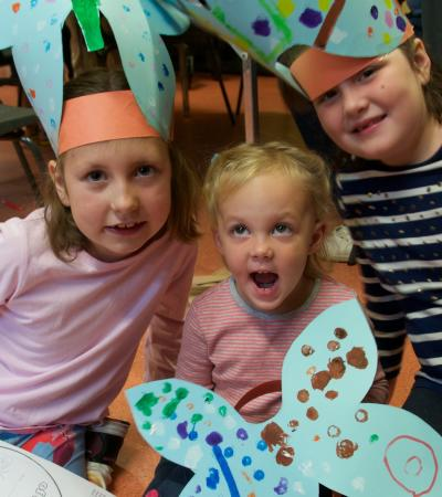 Kids make butterfly hats at Ipswich Museum
