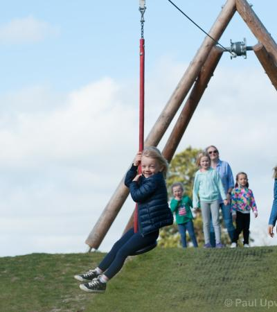 Girl on zip wire at Stonor park in Henley on Thames