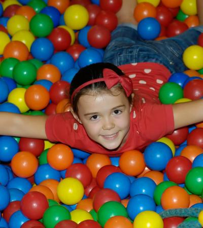 Girl in ball pit at Kids Play Kettering