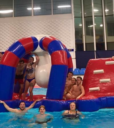 Kids on inflatable assault course in pool at Dewsbury Sports Centre