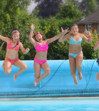 Kids jumping into pool at Woburn Open Air Swimming Pool