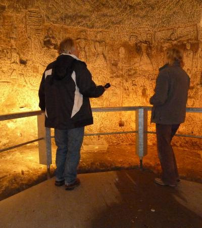People looking at cave carvings at Royston Cave