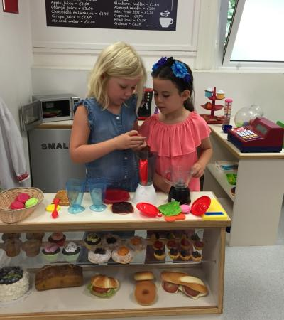 Kids in role play kitchen at Little Street Play Centre in Camberley