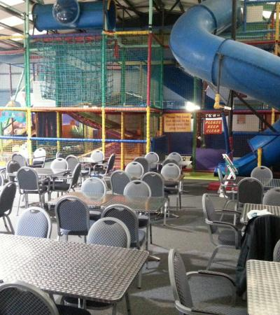 Indoor soft play frame and seating area at Merry Go Round in Sittingbourne