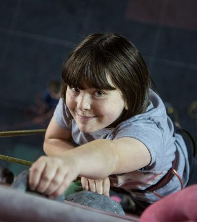 Girl climbing at Awesome Walls Climbing Stoke in Stoke on Trent