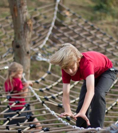 Boy on tree top net at Wild Kingdom Playspace in London