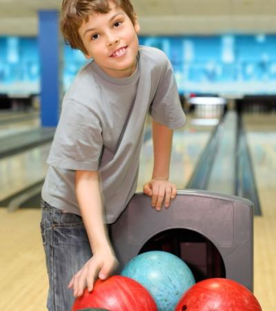 Boy bowling at Play2Day Family Entertainment Centre in Wisbech