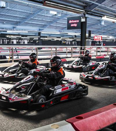 People go kart racing at TeamSport Karting London Docklands in Charlton