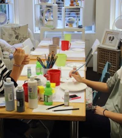 Girls painting at Paint Your Own Ceramics with Callis Corner in Dorking