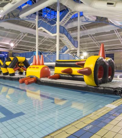 Inflatable course in swimming pool at Towcester Centre for Leisure in Towcester