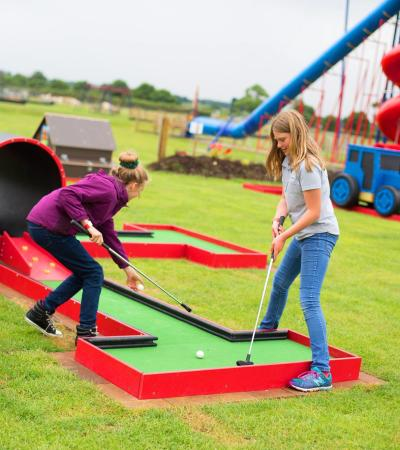 Girls play mini golf at Rand Farm Park in Market Rasen