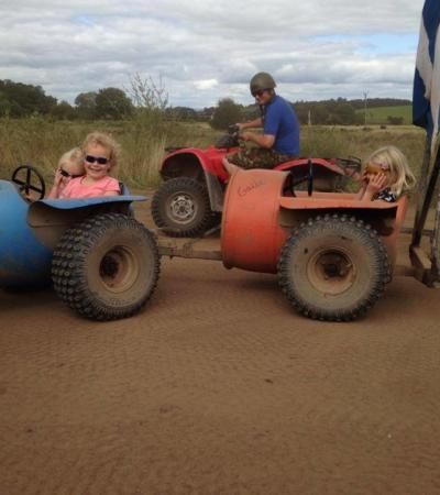 Kids on tractor ride at Farmers Den in Dumfries