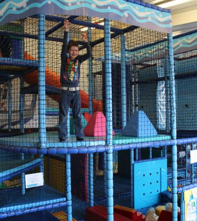 Boy on soft play frame at Captain Willies Activity Centre in Hunstanton