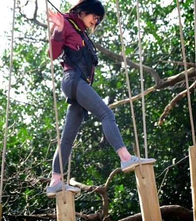Girl on high rope course at Skywalk Adventure in Esher