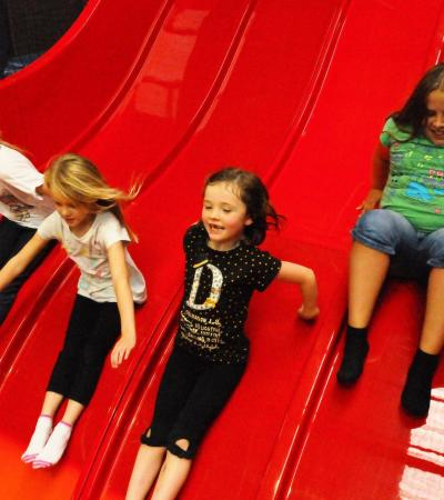 Girls on slide at Tigers Indoor Play in Daventry