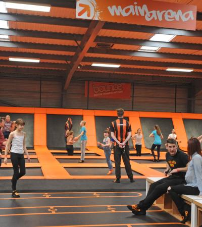 People jumping on trampolines at Bounce Indoor Trampoline Park in Milton Keynes