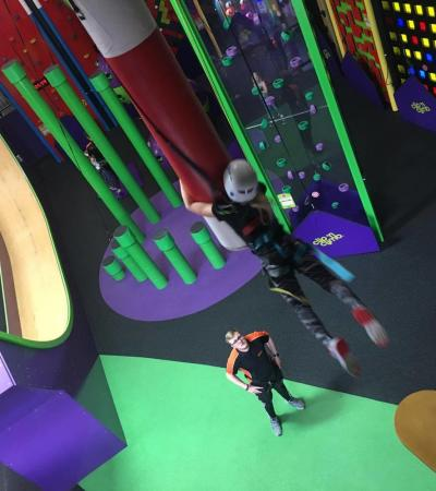 Girl on high rope course at Velocity Trampoline Park Wigan