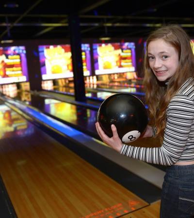 Girl bowling at Superbowl
