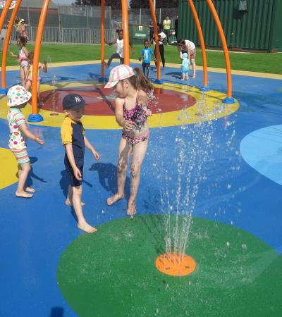 Kids playing in water area at Wimbledon Sprinkler Park in Merton