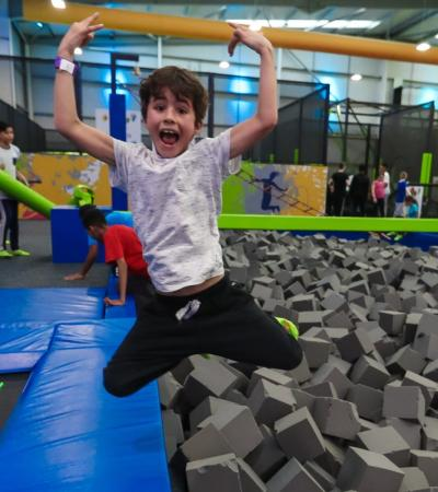 Boy jumping into foam pit at Go Jumpin