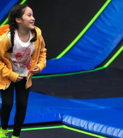 Girl jumping at Jump In Trampoline Arena