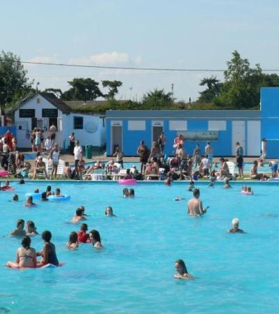 People swimming at Brightlingsea Open Air Pool in Colchester