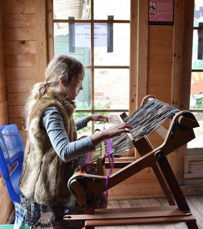 Girl weaving at Stonebridge City Farm in Nottingham