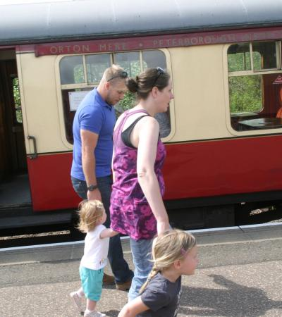 Family alongside train at Nene Valley Railway in Peterborough