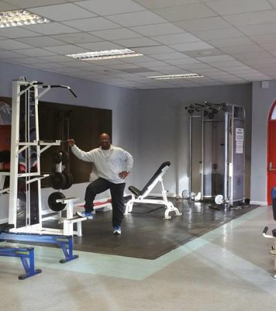 Trainer by gym equipment at Kingstanding Leisure Centre in Birmingham
