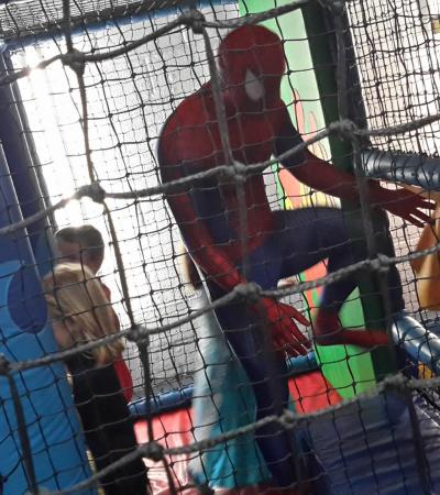 Kids and Spiderman playing on soft play frame at Whale of a Time in Cambridge