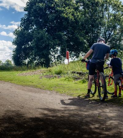 Family cycling at Kingsbury Water Park in Sutton Coldfield