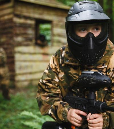 A child holding a paintball gun at KidsPaintball in Brighton
