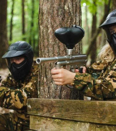 Two kids playing paintball at KidsPaintball  in Woking