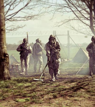 People paintballing at Hack Green Secret Nuclear Bunker in Nantwich