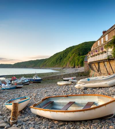 Boats along shore at Clovelly Village in Bideford