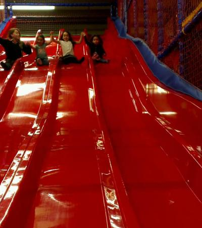 Girls on slide at Fun 2 Play in Thetford