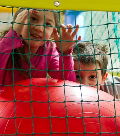 Kids playing on soft play frame at Malibus Soft Play in Barnet
