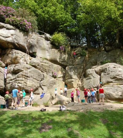 Families rock climbing at Bowles Outdoor Activity Centre in Tunbridge Wells