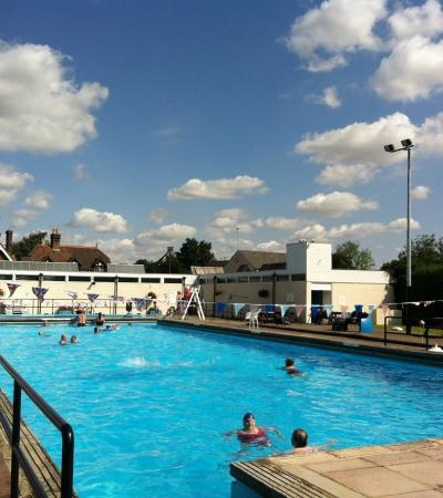 People swimming at The Priory Lido in Ware