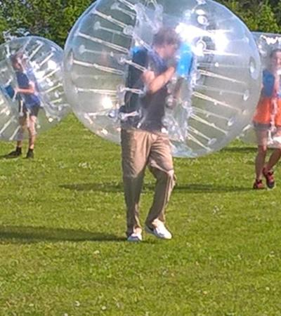 Kids playing zorb football at Haverhill Leisure Centre